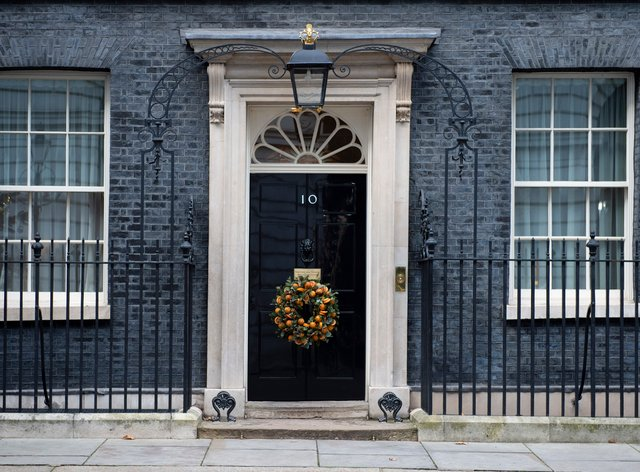 A Christmas wreath is displayed on the door of 10 Downing Street last year (David Mirzoeff/PA)