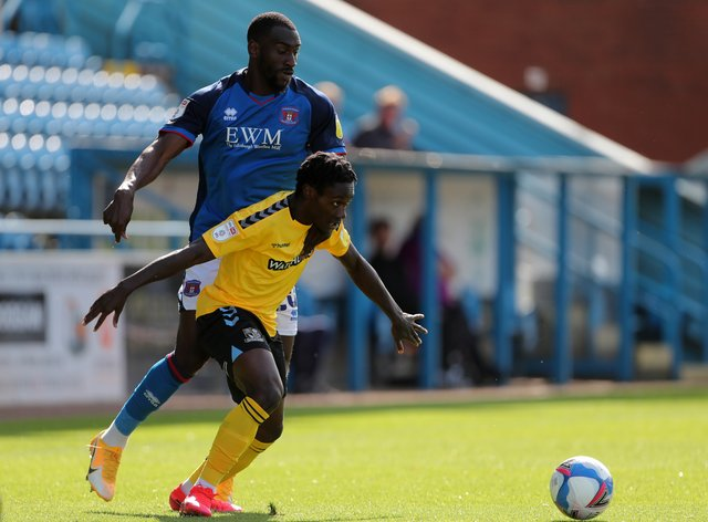 Gime Toure (left) is suspended for Carlisle