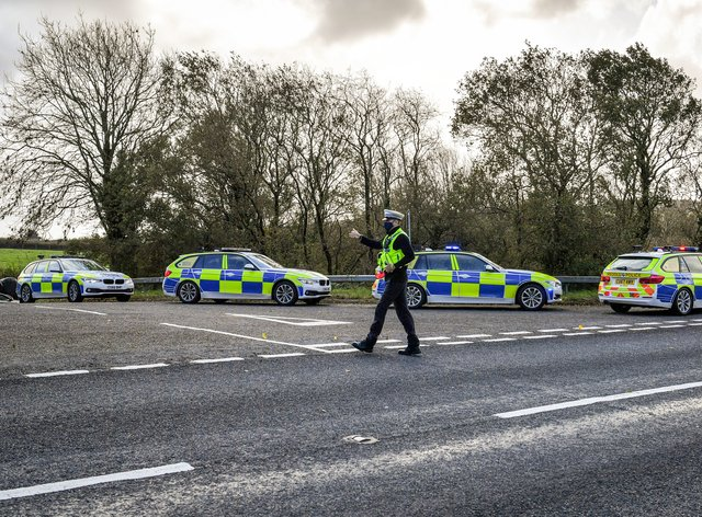 Welsh police pull over cars at a checkpoint close to the border between Carmarthenshire and Pembrokeshire