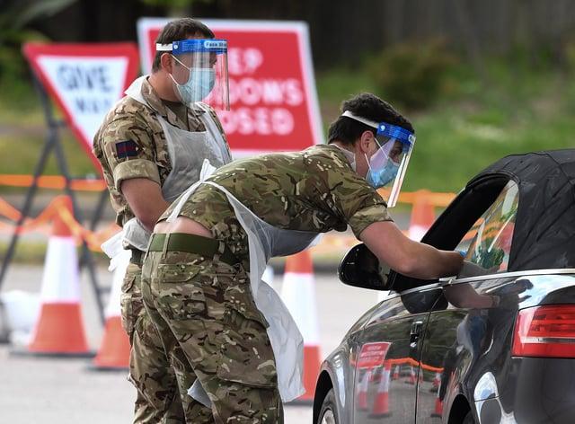 Soldier taking coronavirus swab