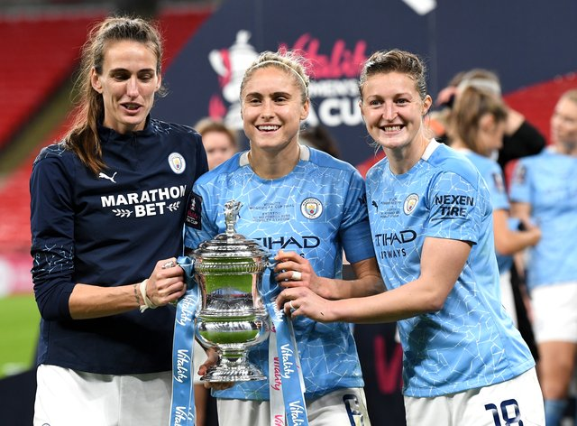 Steph Houghton, centre, and her Manchester City team-mates were still celebrating their Women's FA Cup win on Monday