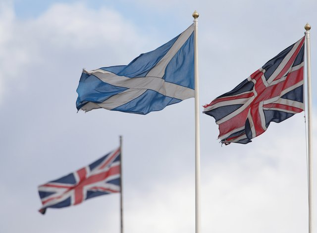 A Saltire flag and two union flags