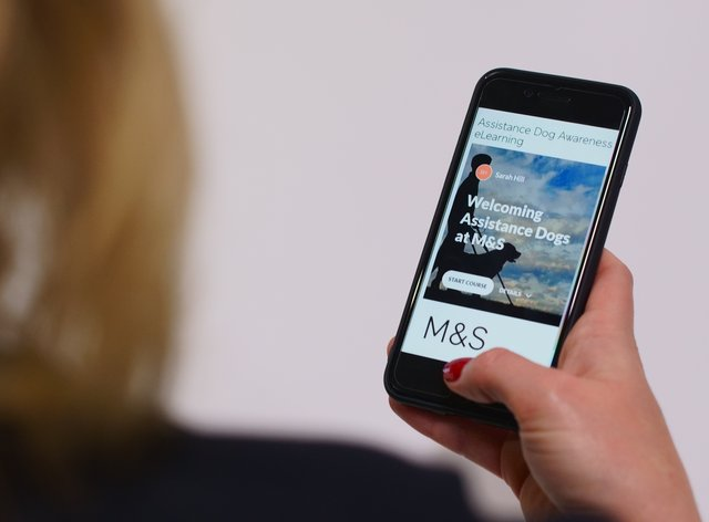 The M&S assistance dogs app on a smartphone