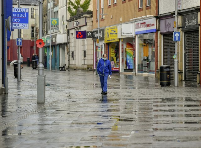 A lone man walks through the shopping centre of Bridgend