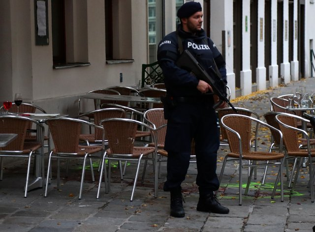 A police officer guards the crime scene at a bar in Vienna, Austria