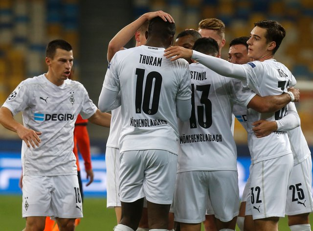 Borussia Monchengladbach's Alassane Plea celebrates with his team-mates after scoring his side's third goal at Shakhtar Donetsk (Efram Lukatsky