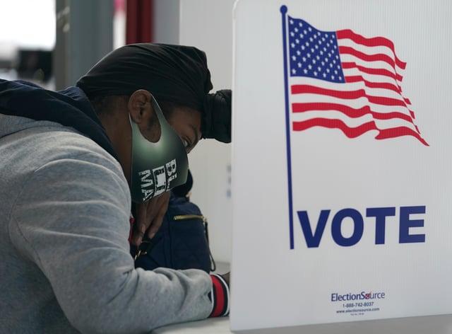 A voter casts her ballot in Louisville, Kentucky