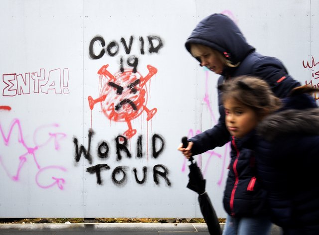 Graffiti that reads 'Covid 19 World Tour' in Edinburgh city centre