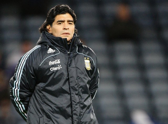 Diego Maradona is said to be in good spirits following a brain operation.