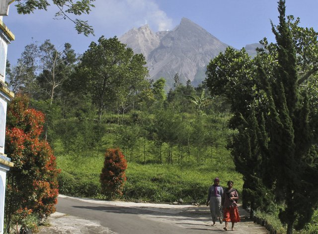 Mount Merapi is seen in the background in Pemalang, Central Java, Indonesia (Agung Nugroho/AP)