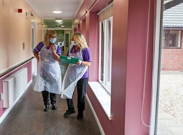 Staff in PPE in a care home