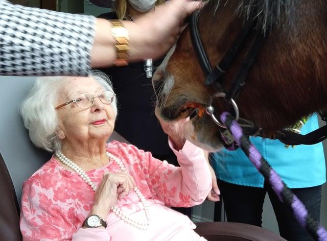 A Covid-19 survivor celebrates her 100th birthday in a care home