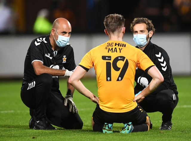Cambridge's Adam May could return for his side's Emirates FA Cup first-round clash with Shrewsbury