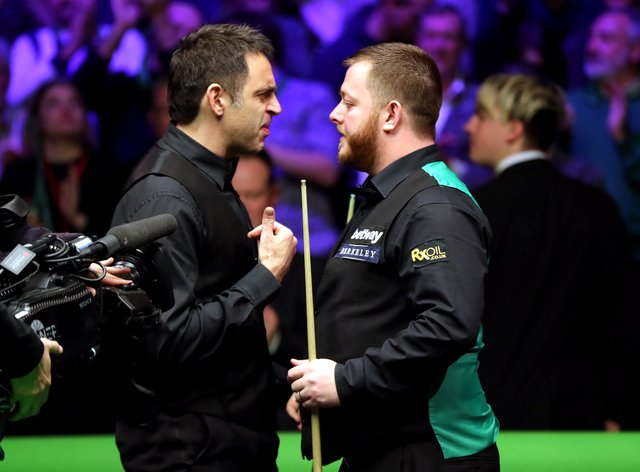 Ronnie O'Sullivan, left, clashed with Mark Allen in Milton Keynes