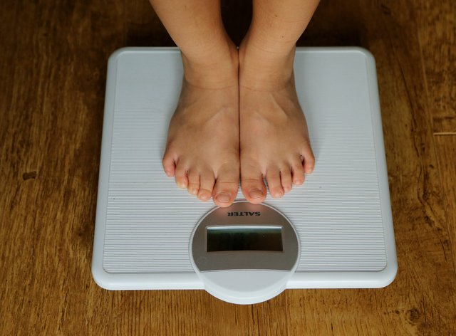 A child is weighed on scales