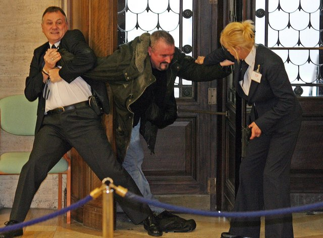 Michael Stone tackled at Stormont