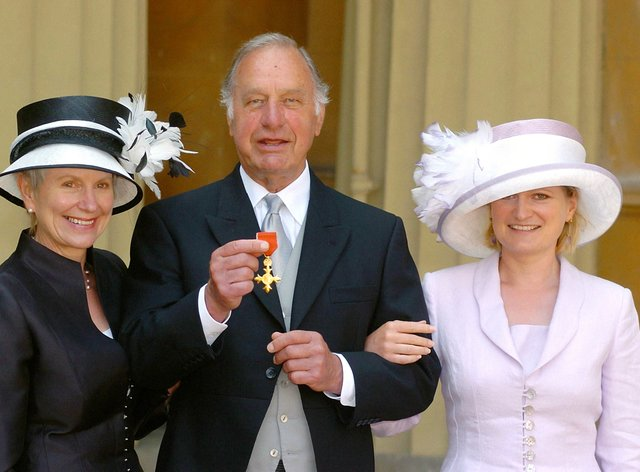 Geoffrey Palmer with his wife Sally and daughter Harriet as he collects his OBE