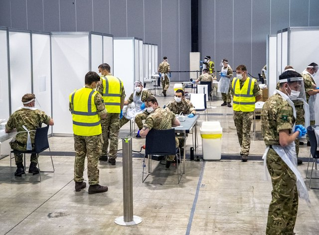 Soldiers at The Exhibition Centre in Liverpool, which has been set up as a testing centre in the city