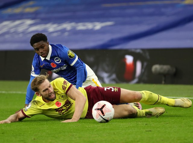 Tariq Lamptey challenges Charlie Taylor at the AMEX Stadium