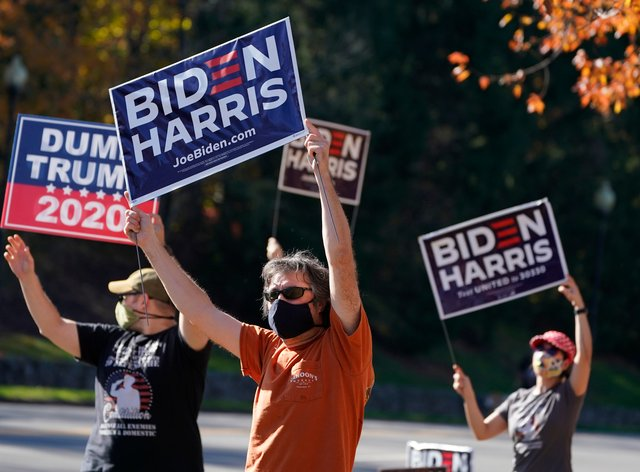 Supporters of president-elect Joe Biden wave signs