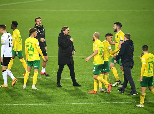Norwich manager Daniel Farke celebrates with his players after beating Swansea
