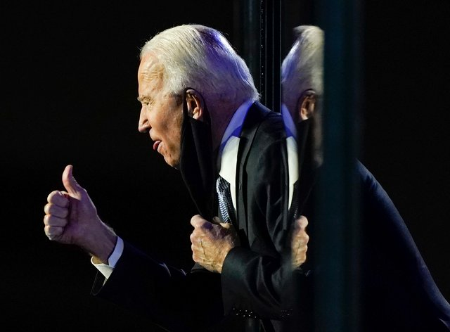 President-elect Joe Biden gestures to the crowd after he spoke on Saturday