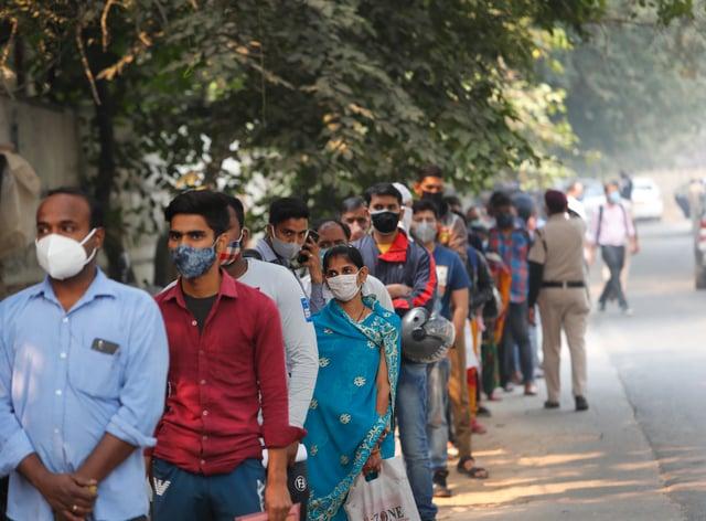 People queue for coronavirus tests in New Delhi, India