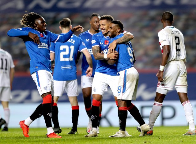 James Tavernier, centre, and Rangers celebrate their eighth goal