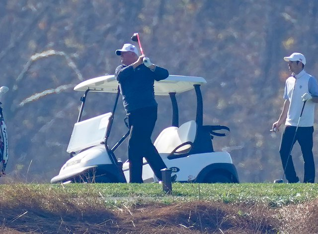 President Donald Trump plays golf at Trump National, Virginia, on Sunday, while maintaining his silence over his next moves