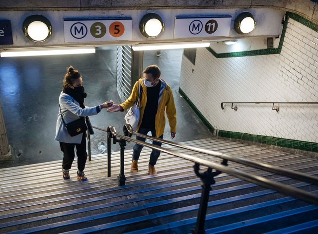 A couple in an underground station