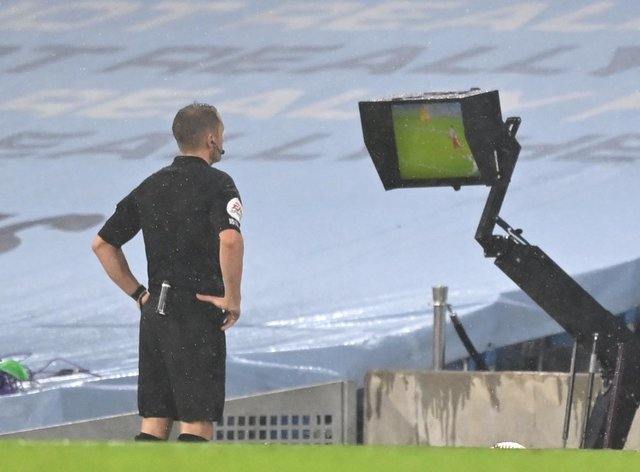 Referee Craig Pawson was one of a number of referees to consult his pitchside monitor over VAR calls
