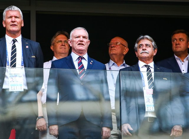 <p>FA chairman Greg Clarke (centre) apologised for using the word 'coloured' during an answer to MPs at a DCMS committee hearing</p>