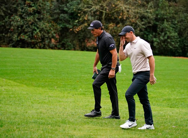 Phil Mickelson, left, and Rory McIlroy during practice for the Masters