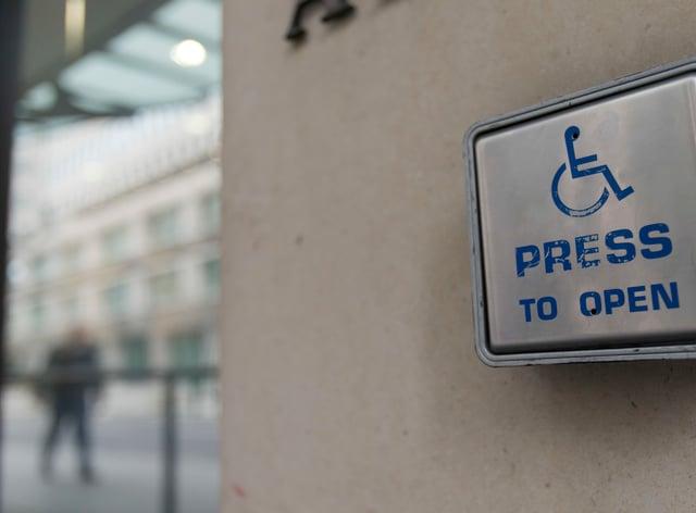 A wheelchair access door entry button