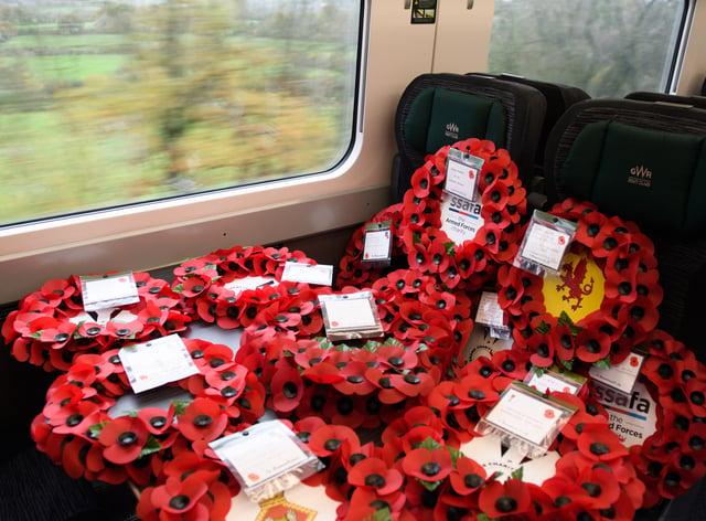 Poppy wreaths on a train