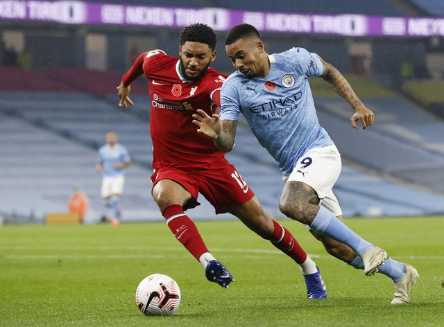 Liverpool's Joe Gomez (left) is reported to have suffered an injury during England training.