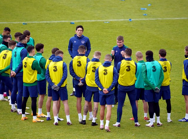Republic of Ireland manager Stephen Kenny (centre right) and assistant Keith Andrews (centre left) speak to the players during their training