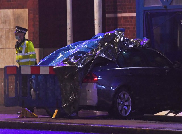 A man has been arrested after a vehicle collided with the police station