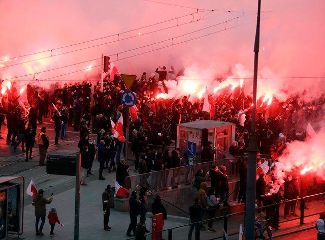 People take part in an annual Independence Day march organised by far-right groups, in Warsaw, Poland (Czarek Sokolowski/AP)