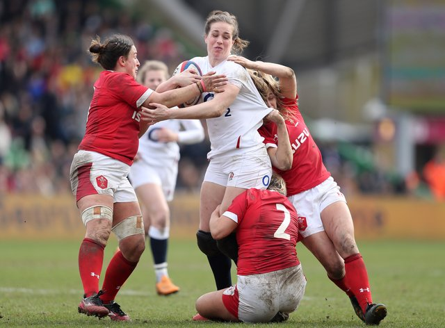 <p>Emily Scarratt (centre) is set to lead her squad at the weekend</p>
