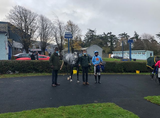 Bachasson with trainer Willie Mullins (left) and jockey David Mullis (right) after his victory in the Clonmel Oil Chase