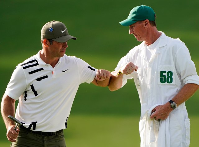 Paul Casey celebrates with his caddie John MacLaren after his opening 65 at the Masters