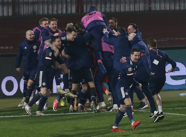 Scotland players celebrate their play-off success