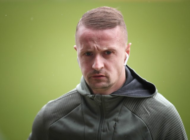 Leigh Griffiths has apologised to Northern Ireland striker Kyle Lafferty
