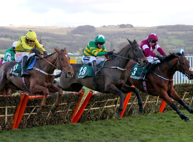 Saint Roi (middle) jumps the last flight on the way to winning the County Handicap Hurdle at Cheltenham