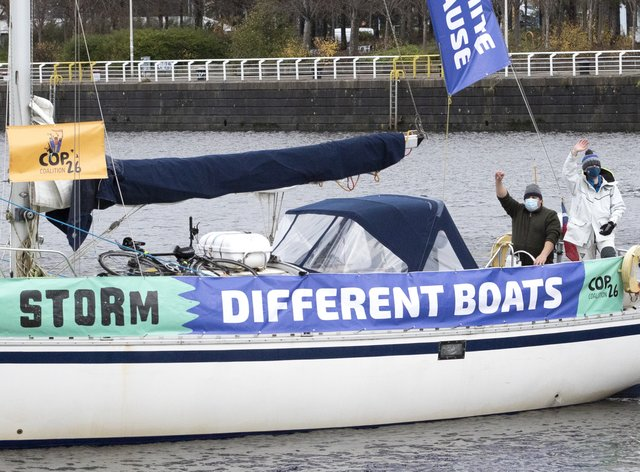People take part in an All Hands On Deck: Action for Climate Justice protest along the River Clyde in Glasgow (Jane Barlow/PA)