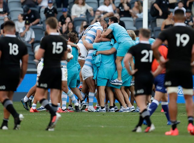 Argentina players celebrate beating New Zealand for the first time at the 30th attempt