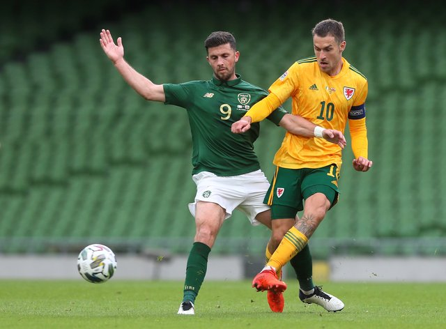 Shane Long (left) and Aaron Ramsey (right) in action during the Nations League tie between the Republic of Ireland and Wales in Dublin last month (Brian Lawless/PA)