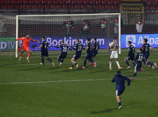 Scotland qualified for their first major tournament in 22 years with a penalty shoot-out win in Serbia on Thursday