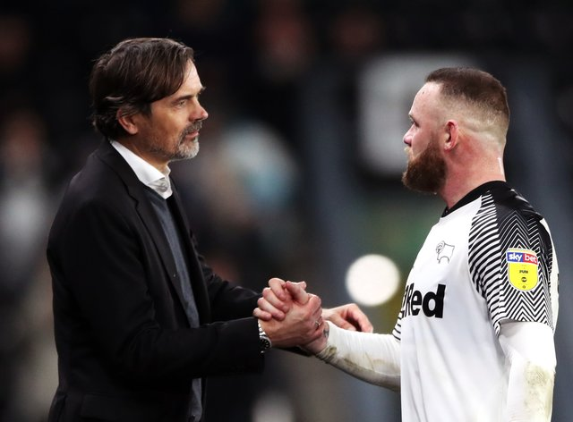 Wayne Rooney is set to step up his coaching duties following the departure of manager Phillip Cocu (left)